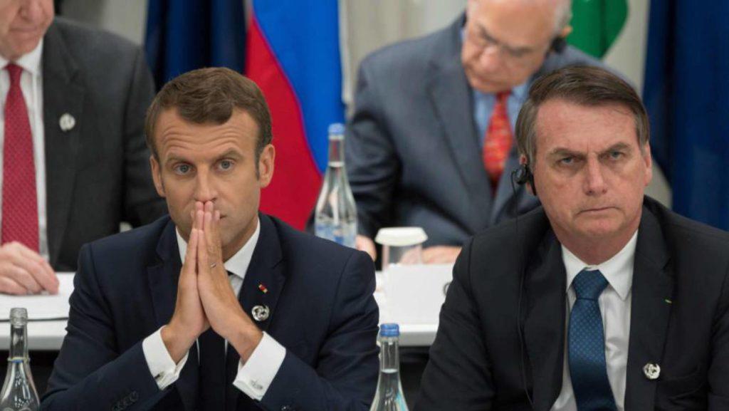El presidente francés, Emmanuel Macron, y el presidente de Brasil, Jair Bolsonaro durante la cumbre del G20 en Osaka en junio pasado. (AFP/Reprodução do El País)