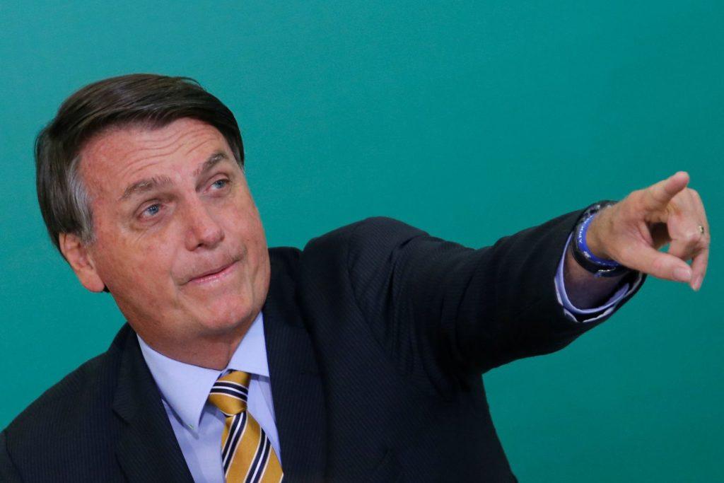 El presidente de Brasil, Jair Bolsonaro, en el Palacio de Panalto. ADRIANO MACHADO / REUTERS (Reprodução do El País)